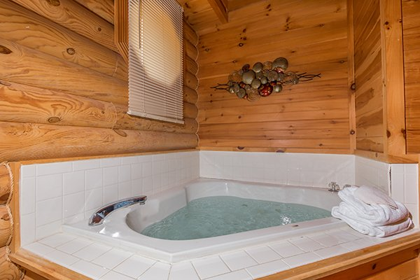 Jacuzzi in a corner at Kountry Lovin', a 2 bedroom cabin rental located in Pigeon Forge