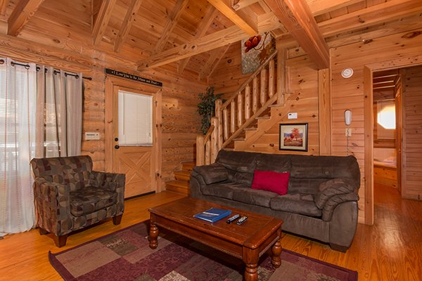 Sofa and chair in the living room at Kountry Lovin', a 2 bedroom cabin rental located in Pigeon Forge
