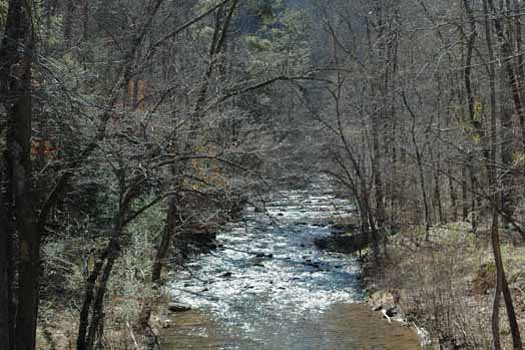 Mountain stream flowing at Smoky Ridge Resort, at Kountry Lovin', a 2 bedroom cabin rental located in Pigeon Forge