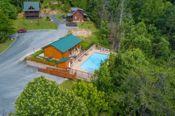 The pool is available for guests at Kountry Lovin', a 2 bedroom cabin rental located in Pigeon Forge