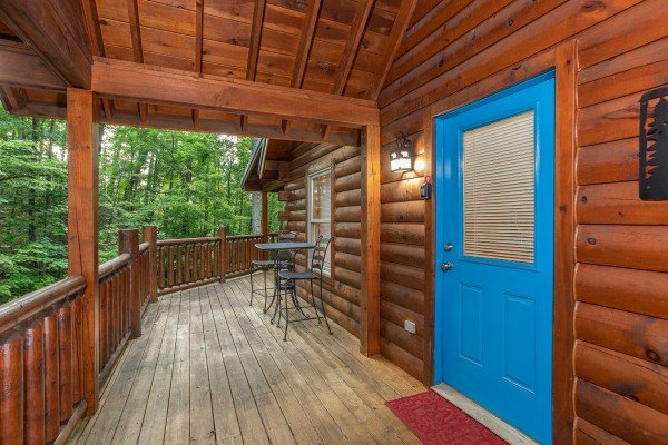 Bistro dining set next to the covered deck at Lazy Mountain Retreat, a 1 bedroom cabin rental located in Gatlinburg