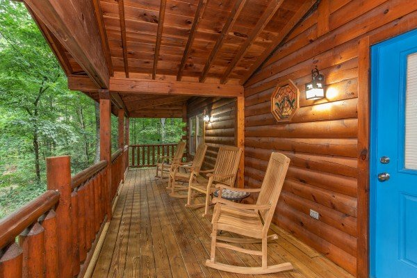 Rocking chairs on the covered deck at Lazy Mountain Retreat, a 1 bedroom cabin rental located in Gatlinburg