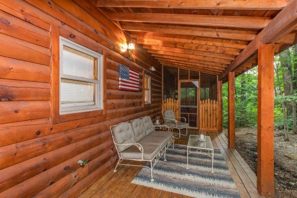 Bench and chair seating on the lower level deck at Lazy Mountain Retreat, a 1 bedroom cabin rental located in Gatlinburg