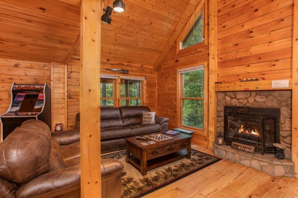 Fireplace in the living room at Lazy Mountain Retreat, a 1 bedroom cabin rental located in Gatlinburg