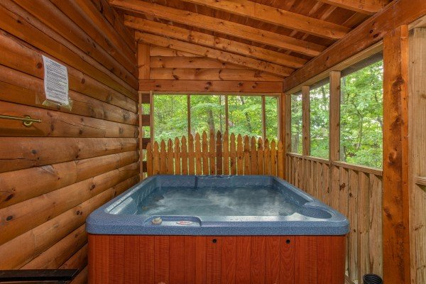Hot tub on the covered porch at Lazy Mountain Retreat, a 1 bedroom cabin rental located in Gatlinburg