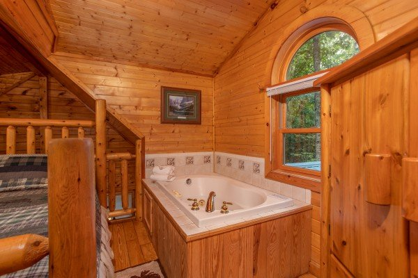 Jacuzzi in the loft room at Lazy Mountain Retreat, a 1 bedroom cabin rental located in Gatlinburg