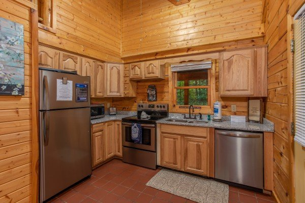 Kitchen with stainless steel appliances at Lazy Mountain Retreat, a 1 bedroom cabin rental located in Gatlinburg