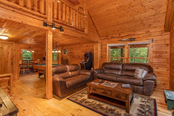 Loveseat and sofa bed in the living room at Lazy Mountain Retreat, a 1 bedroom cabin rental located in Gatlinburg