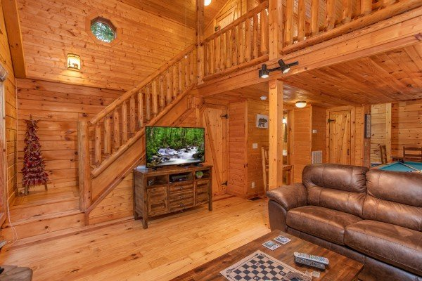 TV on an entertainment console in the living room at Lazy Mountain Retreat, a 1 bedroom cabin rental located in Gatlinburg