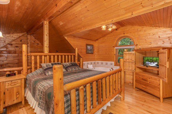King log bed in the loft space at Lazy Mountain Retreat, a 1 bedroom cabin rental located in Gatlinburg