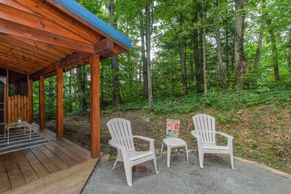 Two plastic Adirondack chairs on a patio at Lazy Mountain Retreat, a 1 bedroom cabin rental located in Gatlinburg