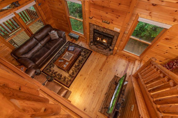 Looking down into the living room from the upper floor at Lazy Mountain Retreat, a 1 bedroom cabin rental located in Gatlinburg