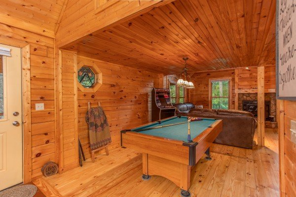 Green felt pool table at Lazy Mountain Retreat, a 1 bedroom cabin rental located in Gatlinburg