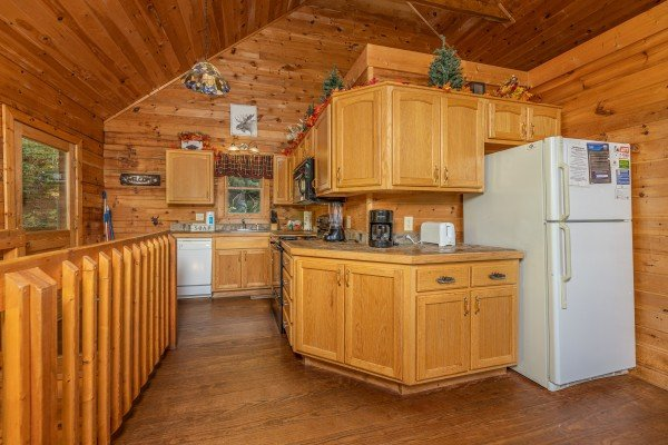 Counters and white refrigerator at Highland Moose, a 2 bedroom cabin rental located in Pigeon Forge