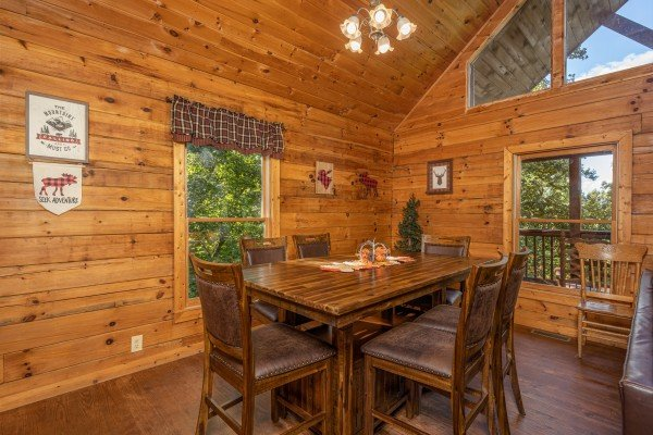 Dining table for six at Highland Moose, a 2 bedroom cabin rental located in Pigeon Forge