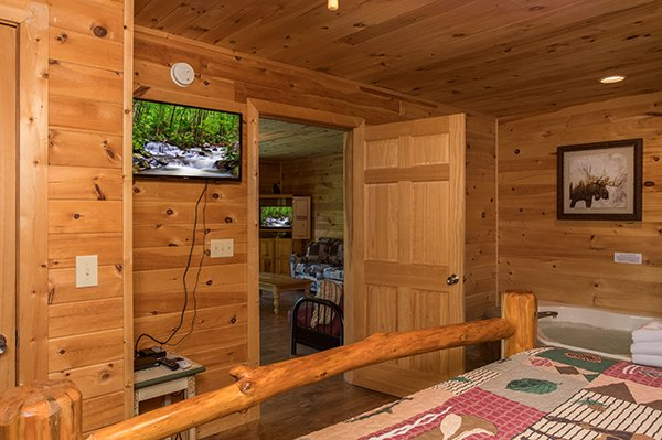 Bedroom with a TV at Highland Moose, a 2 bedroom cabin rental located in Pigeon Forge