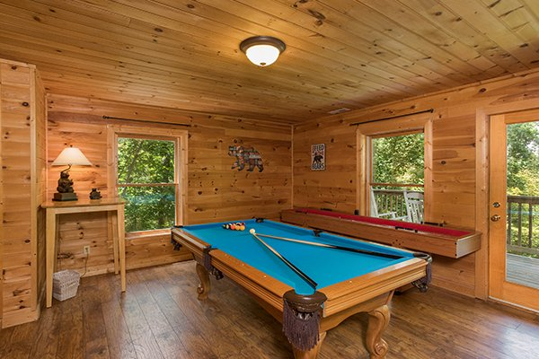 Pool table and shuffleboard in the game room at Highland Moose, a 2 bedroom cabin rental located in Pigeon Forge
