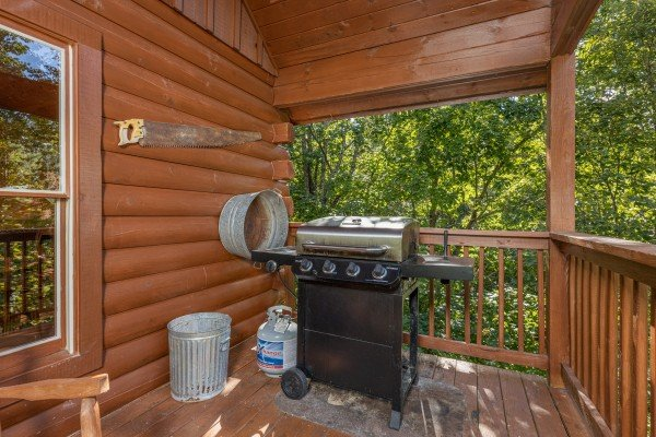 Grill on a covered deck at Highland Moose, a 2 bedroom cabin rental located in Pigeon Forge