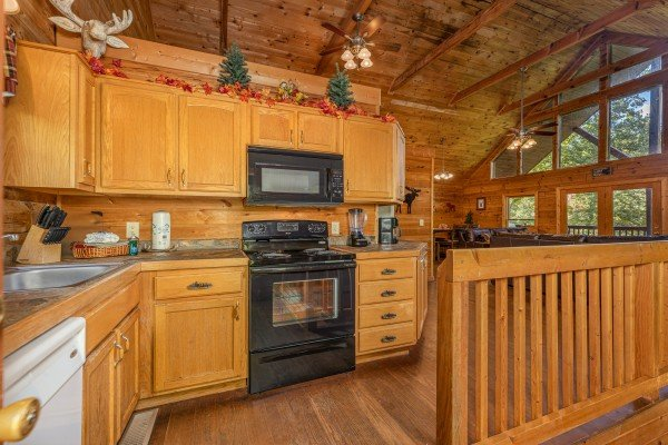 Kitchen with black and white appliances at Highland Moose, a 2 bedroom cabin rental located in Pigeon Forge