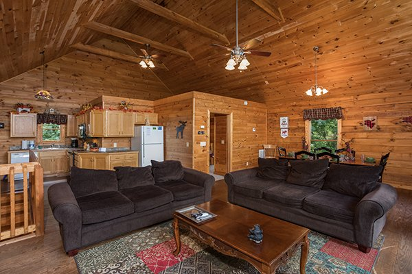 Living room, dining space, and kitchen at Highland Moose, a 2 bedroom cabin rental located in Pigeon Forge