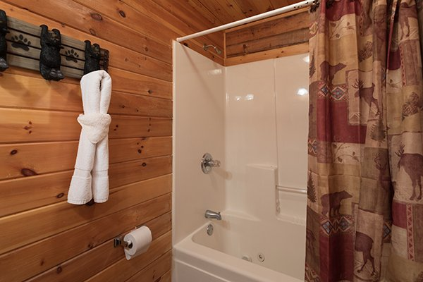 Bathroom with a tub and shower at Highland Moose, a 2 bedroom cabin rental located in Pigeon Forge