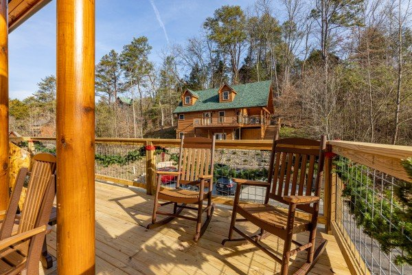 Rocking chairs on a deck at Wet Feet Retreat, a 5 bedroom cabin rental located in Pigeon Forge