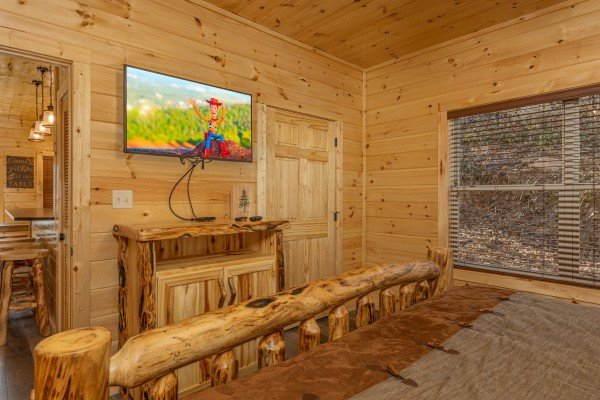 Dresser and TV in a bedroom at Wet Feet Retreat, a 5 bedroom cabin rental located in Pigeon Forge