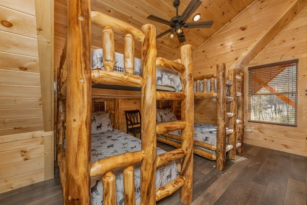 Two sets of bunk beds in a bedroom at Wet Feet Retreat, a 5 bedroom cabin rental located in Pigeon Forge