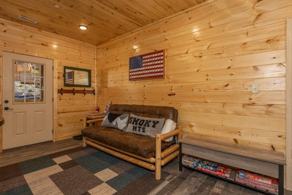 Futon in the game room at Wet Feet Retreat, a 5 bedroom cabin rental located in Pigeon Forge