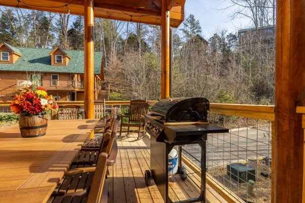 Grill and dining table on the deck at Wet Feet Retreat, a 5 bedroom cabin rental located in Pigeon Forge