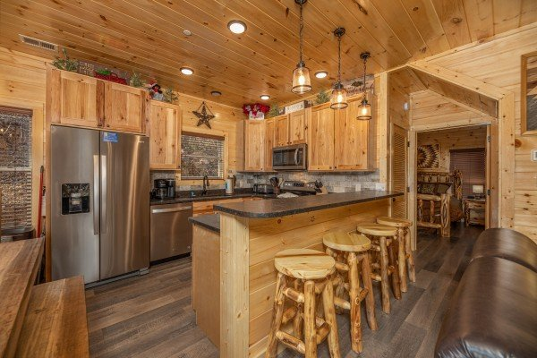Kitchen with breakfast bar for four at Wet Feet Retreat, a 5 bedroom cabin rental located in Pigeon Forge