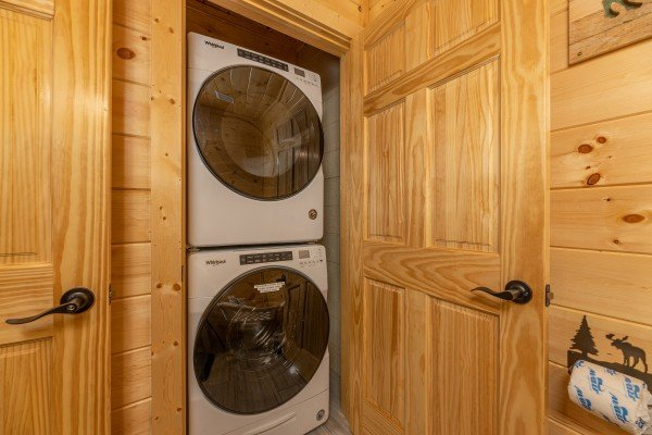 Stacked washer and dryer at Wet Feet Retreat, a 5 bedroom cabin rental located in Pigeon Forge