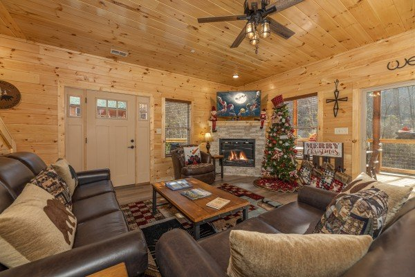 Living room with fireplace and TV at Wet Feet Retreat, a 5 bedroom cabin rental located in Pigeon Forge
