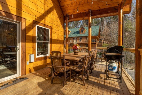 Deck dining and grill at Wet Feet Retreat, a 5 bedroom cabin rental located in Pigeon Forge