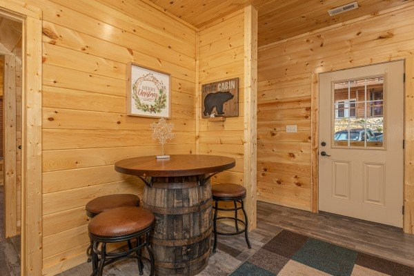 Pub table in a corner at Wet Feet Retreat, a 5 bedroom cabin rental located in Pigeon Forge