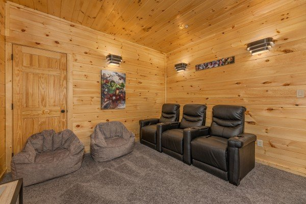 Three recliners and two bean bags in the theater room at Wet Feet Retreat, a 5 bedroom cabin rental located in Pigeon Forge