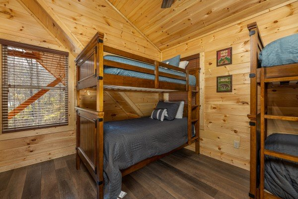 Bedroom with two sets of bunk beds at Wet Feet Retreat, a 5 bedroom cabin rental located in Pigeon Forge