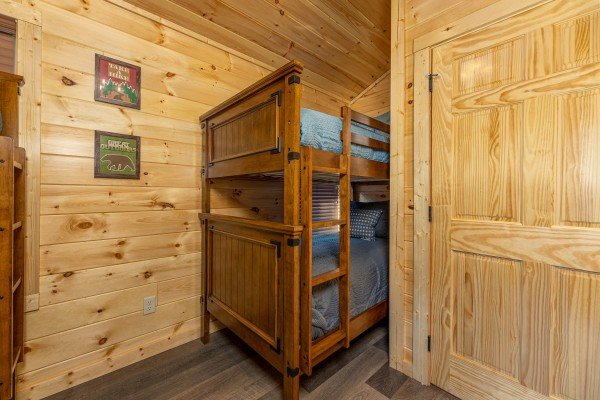 Bunk beds in a bedroom at Wet Feet Retreat, a 5 bedroom cabin rental located in Pigeon Forge