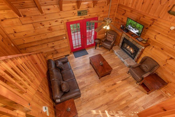 Looking down into the living room at Wonders in the Sky, a 3 bedroom cabin rental located in Gatlinburg