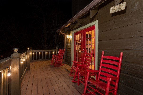 Back deck at night at Wonders in the Sky, a 3 bedroom cabin rental located in Gatlinburg