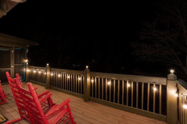 Deck with string lights at Wonders in the Sky, a 3 bedroom cabin rental located in Gatlinburg