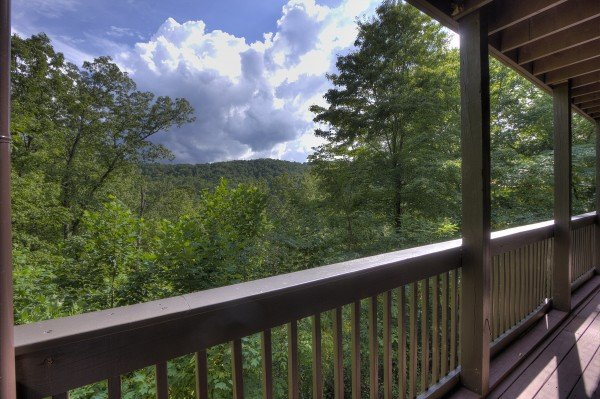 Covered deck and mountain views at Wonders in the Sky, a 3 bedroom cabin rental located in Gatlinburg