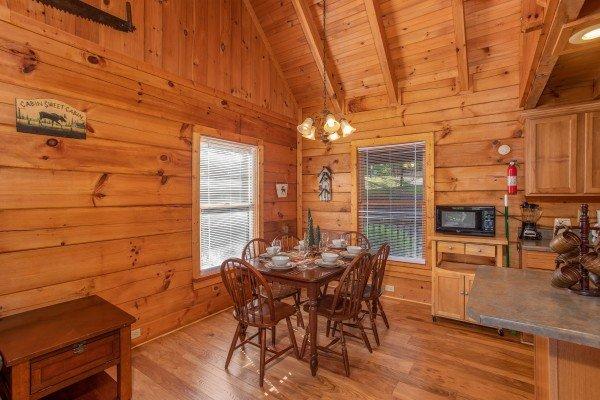 Dining table for six at Wonders in the Sky, a 3 bedroom cabin rental located in Gatlinburg