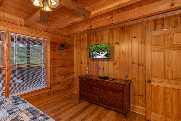 Dresser and TV at Wonders in the Sky, a 3 bedroom cabin rental located in Gatlinburg