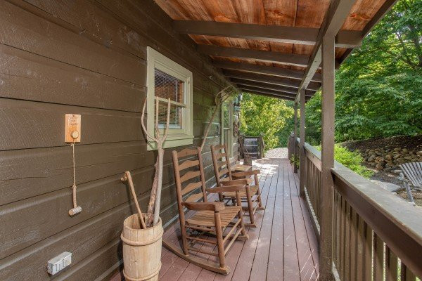 Front porch with rocking chairs at Wonders in the Sky, a 3 bedroom cabin rental located in Gatlinburg