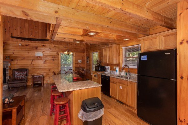 Kitchen with black appliances and dining space at Wonders in the Sky, a 3 bedroom cabin rental located in Gatlinburg