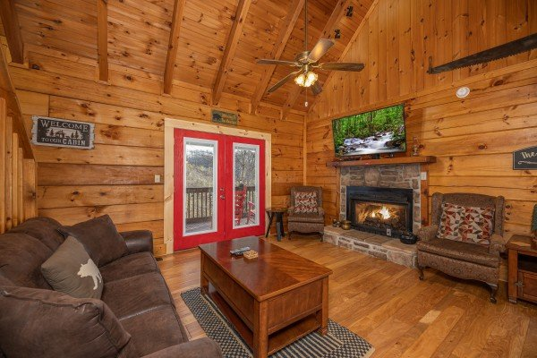 Living room with sofa, fireplace, and TV at Wonders in the Sky, a 3 bedroom cabin rental located in Gatlinburg