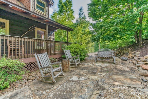 Rocking chairs on a patio in the yard at Wonders in the Sky, a 3 bedroom cabin rental located in Gatlinburg