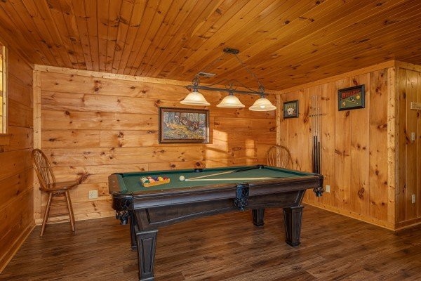 Pool table in the game room at Wonders in the Sky, a 3 bedroom cabin rental located in Gatlinburg