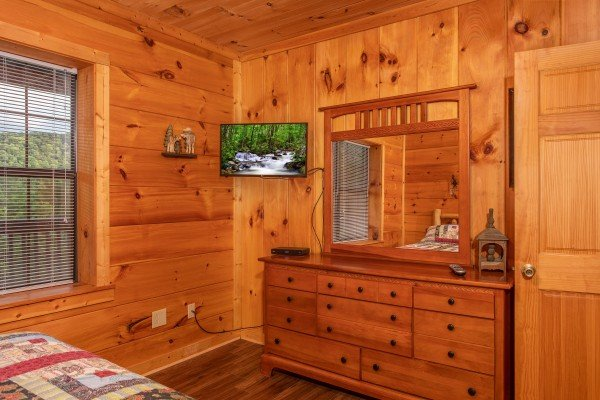 Bedroom with a dresser and TV at Wonders in the Sky, a 3 bedroom cabin rental located in Gatlinburg